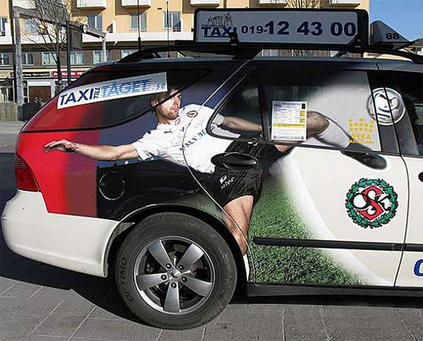 5. Такси Taget. Рукоятка открывания двери такси находится на весьма пикантной части тела фтуболиста. Наверное клиенты этого такси препочитают сидеть рядом с водителем.