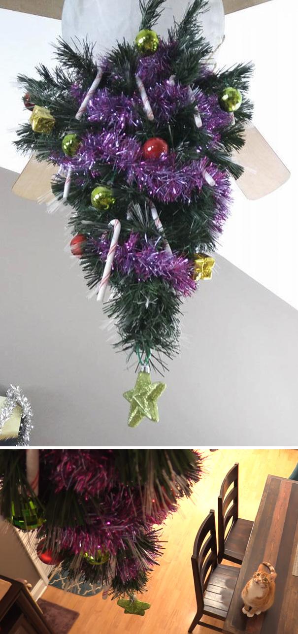 5. Кажется идею подвесить елку к потолку подхватили многие владельцы котов.